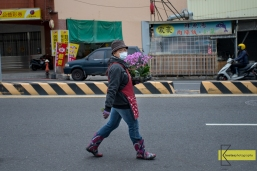 Candid shot of a lady florist walking in the street of Tainan with flower coordinated boots. My camera is always ready for situations like that.
