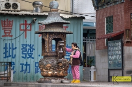 While traveling for photography I like to include local people in their daily activities. Like this lady during her morning prayer in Tainan.