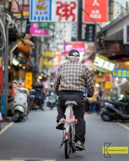 Bicycling in Tamsui street market.